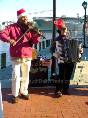 Accordion and Violin Players Singing at the Olde Towne Holiday Music Festival
