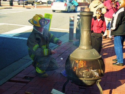 Portsmouth Fire Department Fireman Roasting Marshmallow for Kids