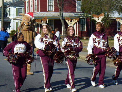 High School Cheerleaders Marching in Parade